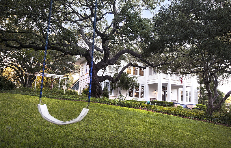 Photo of the Fairview from the front lawn with tree swingset in foreground